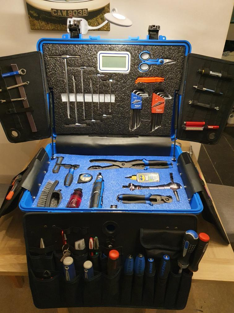 The picture contains a tool box that has all power tools, screwdrivers and much more organised by shadow foam. The foam in the picture has been cut in a way that allows perfect placement for the tools and power tools, allowing for a far more aesthetically pleasing tool box. The tool box is quite large, with the top of the tool box about a quarter of a metre off the ground, with shadow foam and tools in side organised, but also a number of tools attached on the outside of the box. This tool box is used for a BMX mechanic that works in the BMX worldcup and many more international competitions